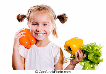 Little girl with the vegetables