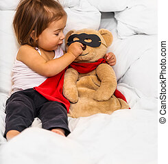little girl with toy super hero