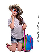 Little girl with travel bag with her finger up