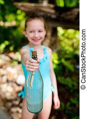Little girl with treasure bottle