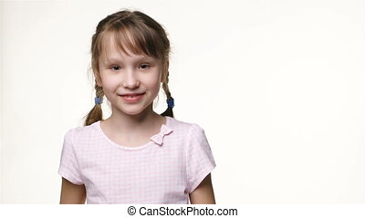 Little girl with two braids looking at camera smiling