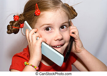 little girl with two cellular phones