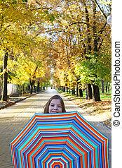little girl with umbrella autumn season