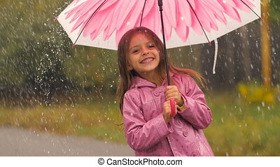 Little Girl With Umbrella Dancing Under Rain