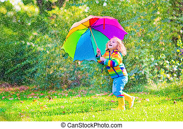 Little girl with umbrella - Funny cute curly toddler girl...