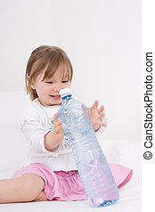 little girl with water