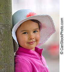 little girl with white summer hat