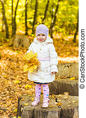 Little girl with yellow leaf.