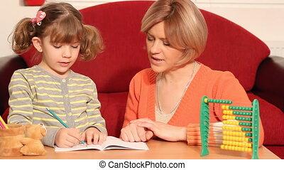 little girl working her homework
