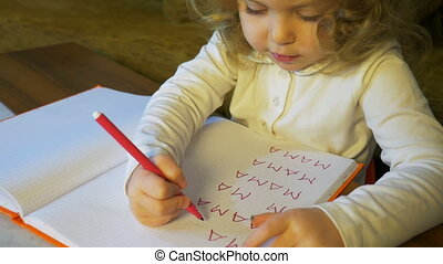 Little girl writing and drawing doing homeworks