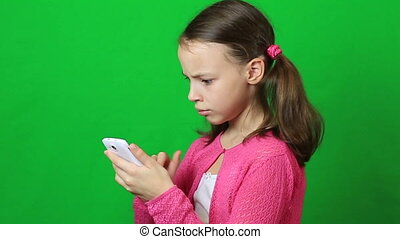 Little girl writing short message on mobile phone