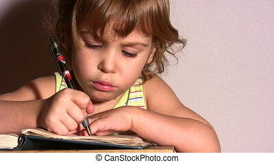Little girl writing