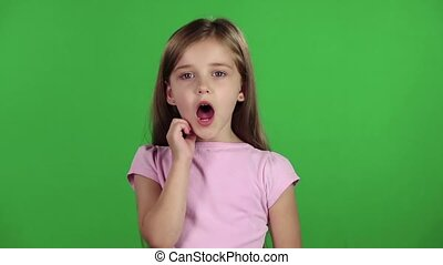 Little girl yawns. Green screen. Slow motion - Little girl...