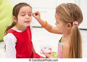 Little girls doing make up