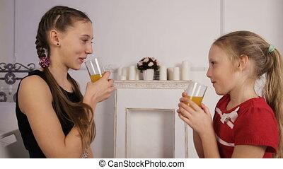 Little girls drinking juice.Girls drinking juice from a...
