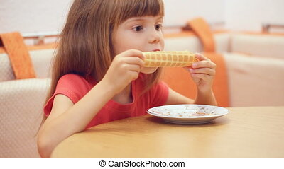 Little girl's eating homemade waffle