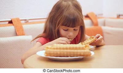 Little girl's eating homemade waffle