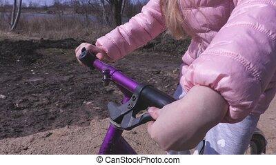 Little girls hands on bike steering