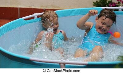 little girls having fun in pool
