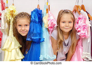 Little girls in shop of dresses