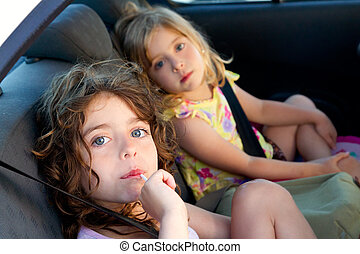 little girls inside car eating candy stick selective focus