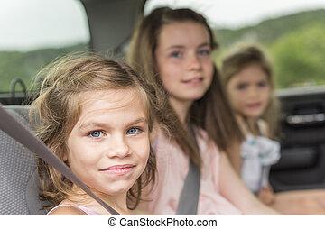 little girls inside car