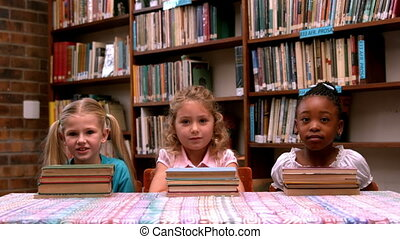 Little girls posing with books