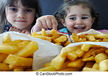 Little girls ready to eat fast food. Children healthcare concept. Real people