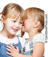 Little girls sharing a secret - Portrait of little girl ...