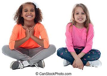 Little girls sitting on floor