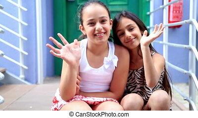 Little girls smiling to a camera