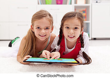 Little girls using tablet computer as artboard - painting ...
