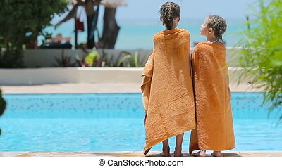 Little girls wrapped in towel after swimming