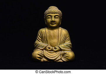 Golden Buddha Statue on a Black Background