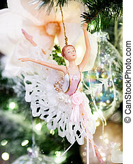 Little graceful ballerina, decorative toy for Christmas tree. Beautiful decoration for New Year celebration.