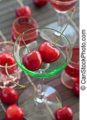Little green glass with fresh cherries