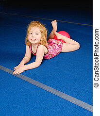 Little Gymnast - A little gymnast on tumbling mat