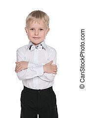 Little handsome schoolboy