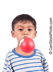 little happy boy blow up balloon