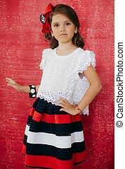 Little happy girl in fashion dress