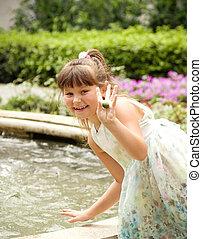 Little happy girl in garden