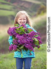girl with a bouquet of lilacs