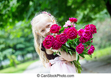 girl with a bouquet of peonies