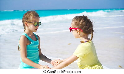 Little happy kids having fun together on the beach -...