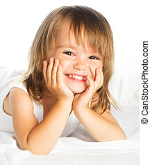 little happy smiling cheerful girl in a bed isolated -...