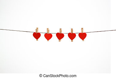 Little hearts hanging on a string