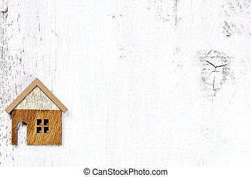 house on wooden background - property real estate concept