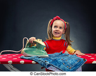 Little housewife - Happy little girl ironing at home
