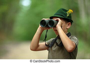 Little hunter with binoculars