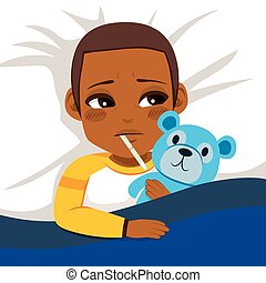 Little African American boy ill in bed with thermometer and hugging blue teddy bear